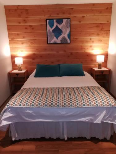 Cama o camas de una habitación en Torres Del Sur Cabañas & Hostal