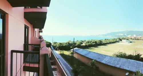 A balcony or terrace at Jurerê Beach Village - Flat