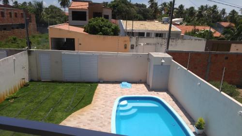 Vista de la piscina de Casa temporada Mosqueiro o alrededores