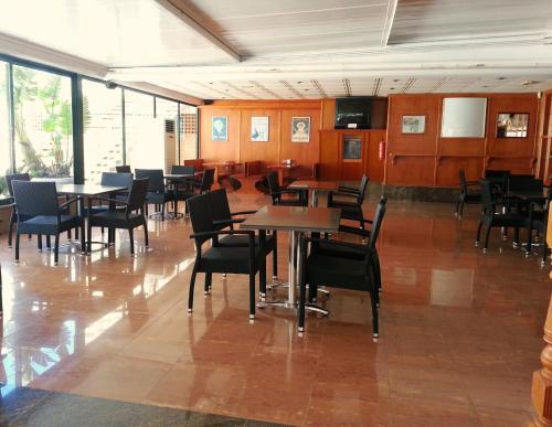 Un restaurante o sitio para comer en Apartamentos Paraiso 10