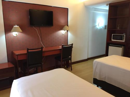 A television and/or entertainment centre at Evandro Apart Hotel