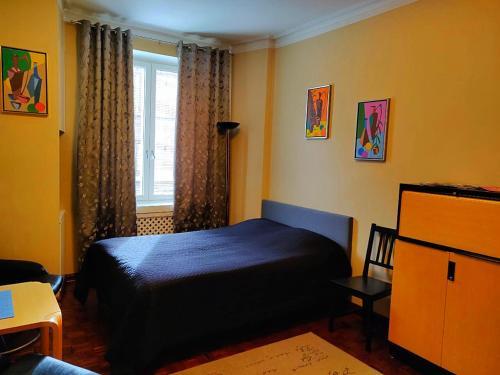 Voodi või voodid majutusasutuse Business style apartment in Helsinki city center toas