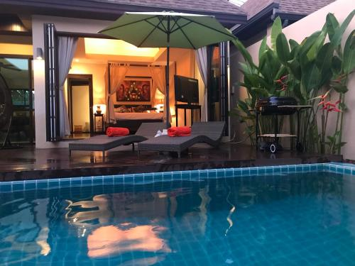 The swimming pool at or near Plunge Tropical Villa