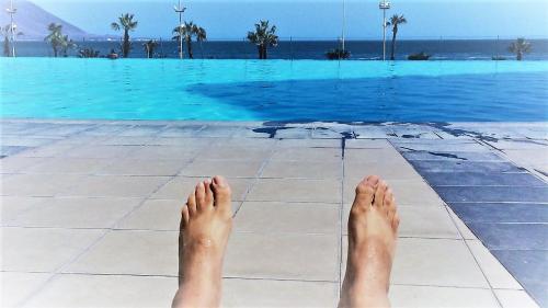 Piscina en o cerca de Condominio Mar Egeo, frente a la playa