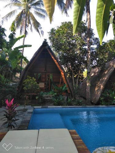 The swimming pool at or close to Kuta Lemon Tree