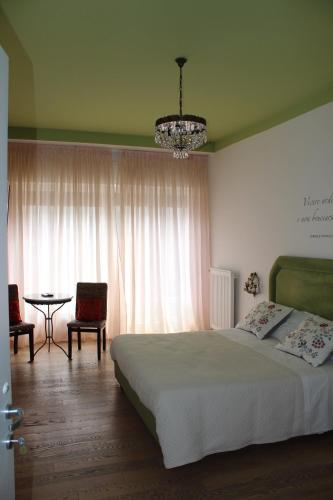 Ein Bett oder Betten in einem Zimmer der Unterkunft La Dimora del Conte