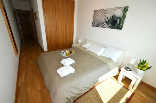 A bed or beds in a room at Expo Oriente Lis