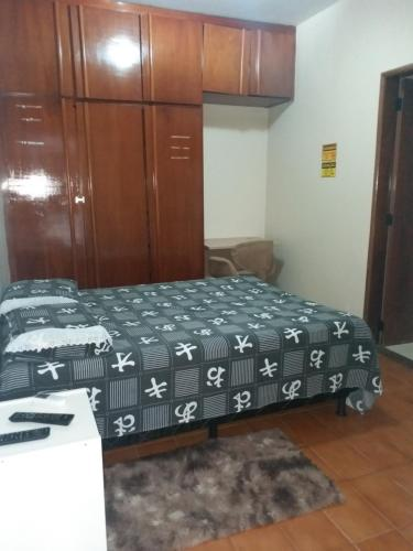 A bed or beds in a room at Flat Stival Bueno