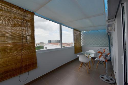 A balcony or terrace at Saigon South Serviced Apartments