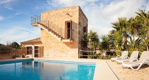 The swimming pool at or near Es moli de na Sebastiana