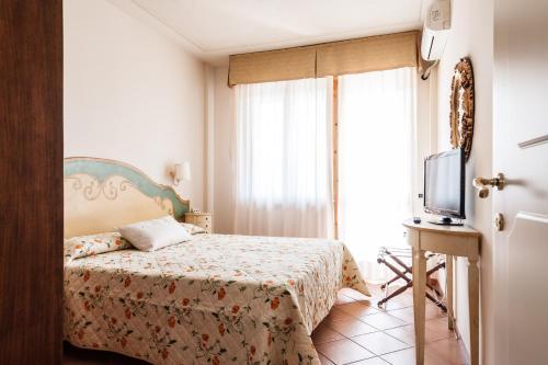 Letto o letti in una camera di Residence Isola Verde Cisanello