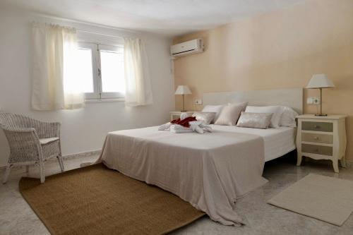 A bed or beds in a room at Hacienda Encanto del Rio