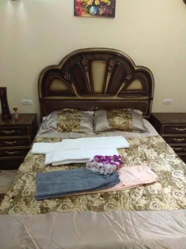 A bed or beds in a room at Apartments Oriental Chalet RedSeaLine