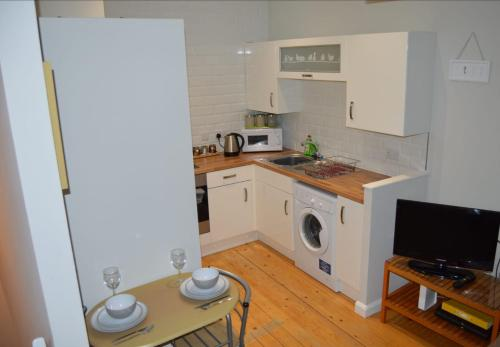 A kitchen or kitchenette at The Wee Upside Down House