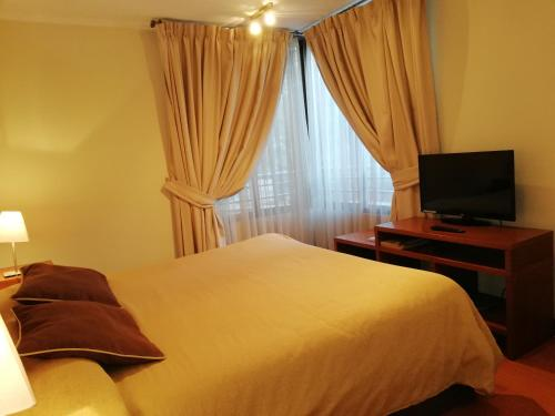 Cama o camas de una habitación en Andes Suites
