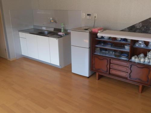 A kitchen or kitchenette at Guest House Misaki Tannowa House