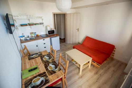 A kitchen or kitchenette at Apartments Pod Kotlom