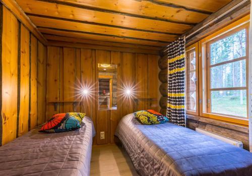 Lova arba lovos apgyvendinimo įstaigoje Levikaira Apartments - Log Cabins