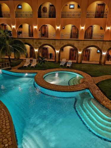 The swimming pool at or close to Corto del Mar Hotel
