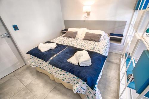 Una cama o camas en una habitación de Studio Belgrano