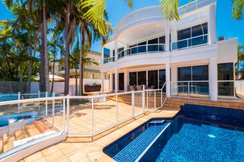 The swimming pool at or near NEW Edgewater On Chevron 5 Bedroom Waterfront House Newly Renovated In Central Location