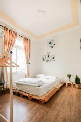 Giường trong phòng chung tại Bisou De La Rivière