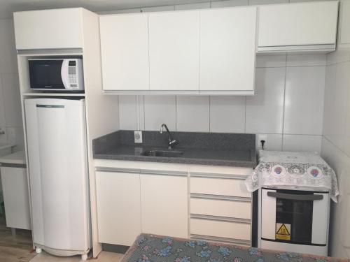 A kitchen or kitchenette at Residencial Varandas
