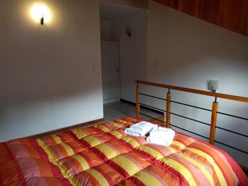 Una cama o camas en una habitación de 845 Teniente Ramayón