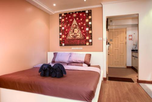 A bed or beds in a room at Nimman Panoramic View