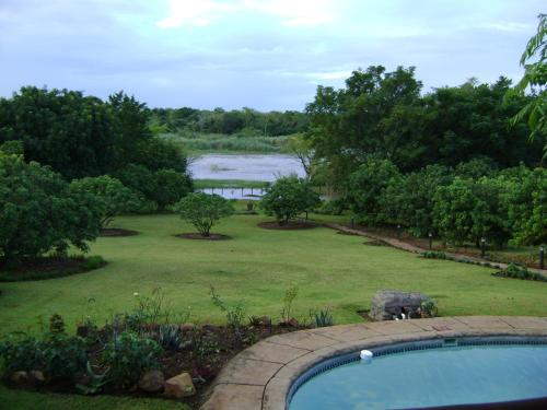 A view of the pool at Orchards Farm Cottages or nearby