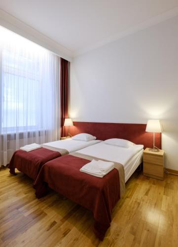 Cama o camas de una habitación en Hotel Metropolis