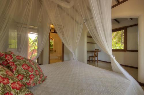 سرير أو أسرّة في غرفة في Casa Natureza Brasil