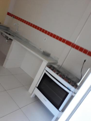 Een keuken of kitchenette bij Férias em Porto Seguro