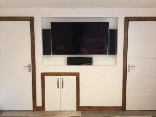 A television and/or entertainment center at Luxury renovated house
