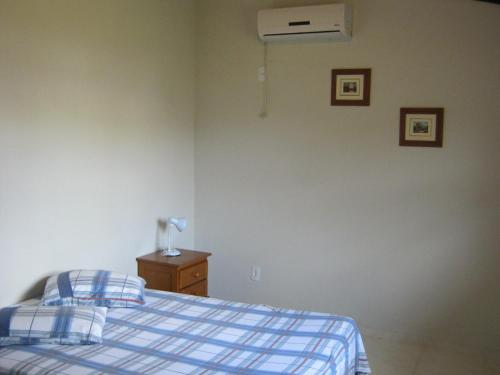 Cama o camas de una habitación en Casa para 5 pessoas perto da praia