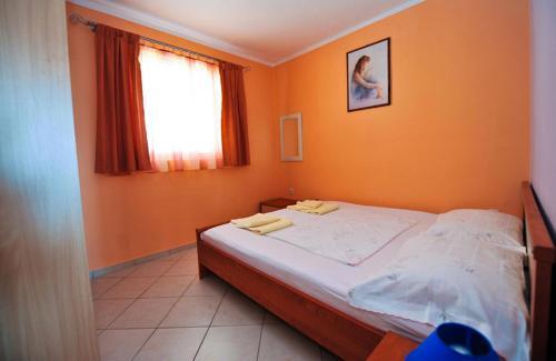 מיטה או מיטות בחדר ב-Apartment Danka