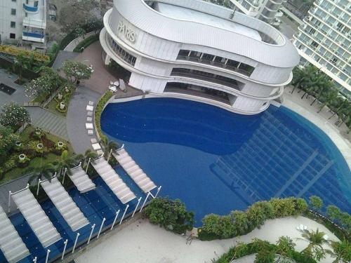 A view of the pool at The Lind's at Azure Urban Resort or nearby