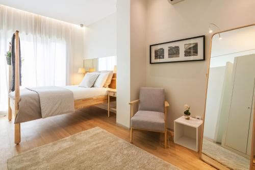 A bed or beds in a room at Inn Oporto Downtown New Apartments