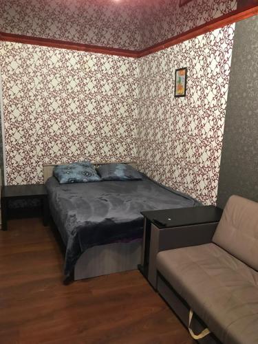 Кровать или кровати в номере Квартира на проспекте Луначарского