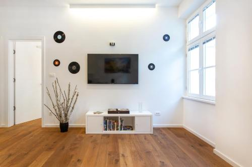 A television and/or entertainment center at Crusader Street Apartments by Loft