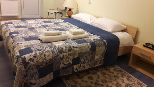 Cama ou camas em um quarto em Gražinos apartamentai