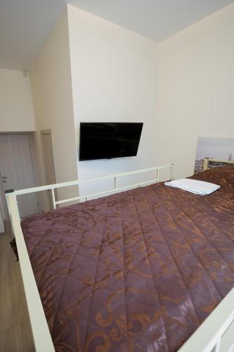 Кровать или кровати в номере Мини-отель на Лебедева 10 В