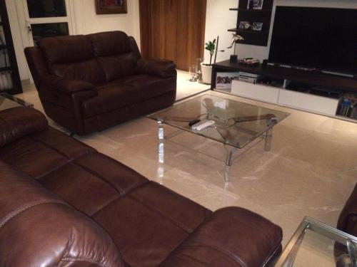 A seating area at 4 BR + Maid Luxurious Apartment in The Palm Jumeirah