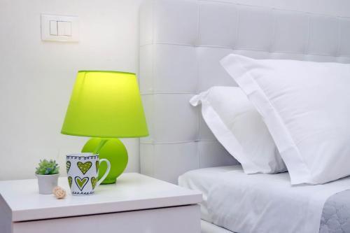 Letto o letti in una camera di Bezzecca Suites