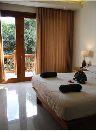 Un ou plusieurs lits dans un hébergement de l'établissement Komodo Lodge