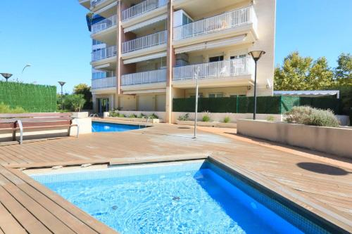 The swimming pool at or near MESTRAL LITORAL COSTA DORADA