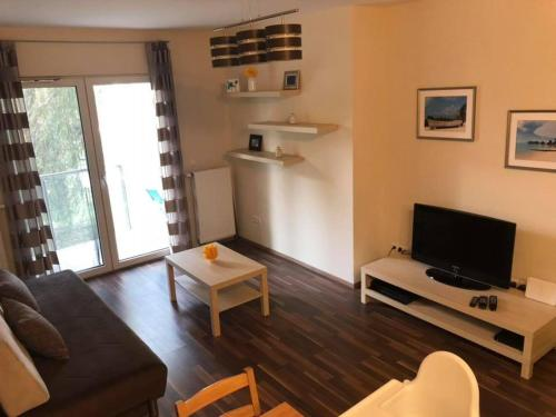 A television and/or entertainment center at Velence Wellness Apartman