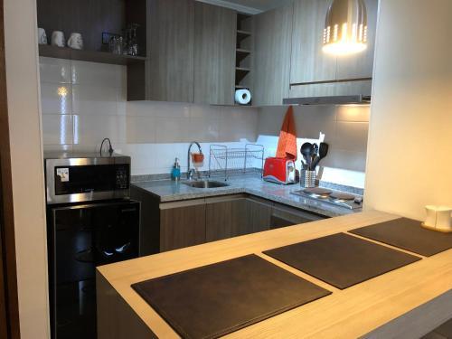 Una cocina o zona de cocina en Depto en Santiago Metro U. de Chile