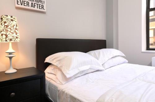 Cama o camas de una habitación en Apartments Upper West Side