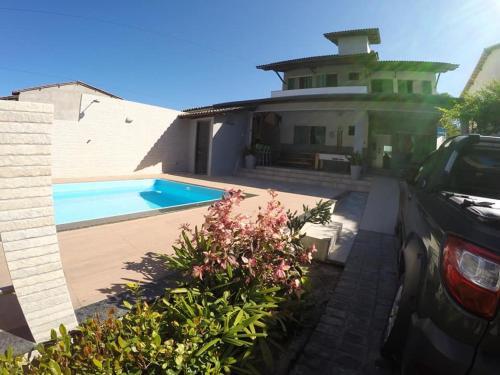 The swimming pool at or near Casa Ilhéus
